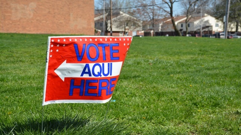 A sign points to a polling place in Cleveland's Central neighborhood.