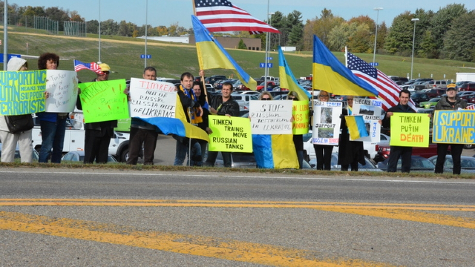 Protesters with Americans for Justice in Ukraine demonstrate outside Timken's headquarters in North Canton Thursday.
