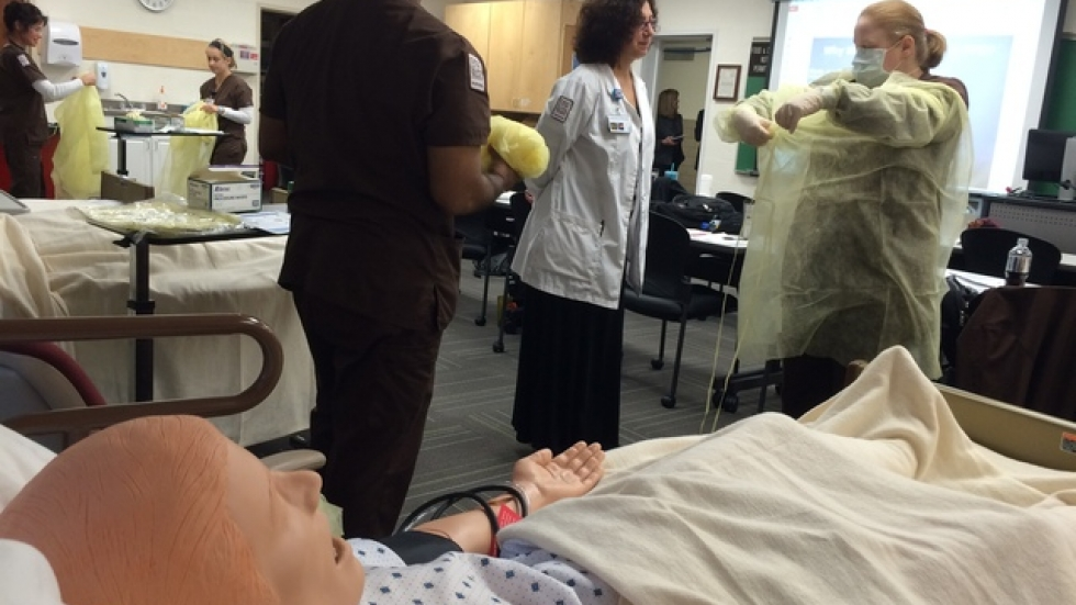 Baldwin Wallace nursing students at today's Ebola Infection Control Lab (pic: Brian Bull)