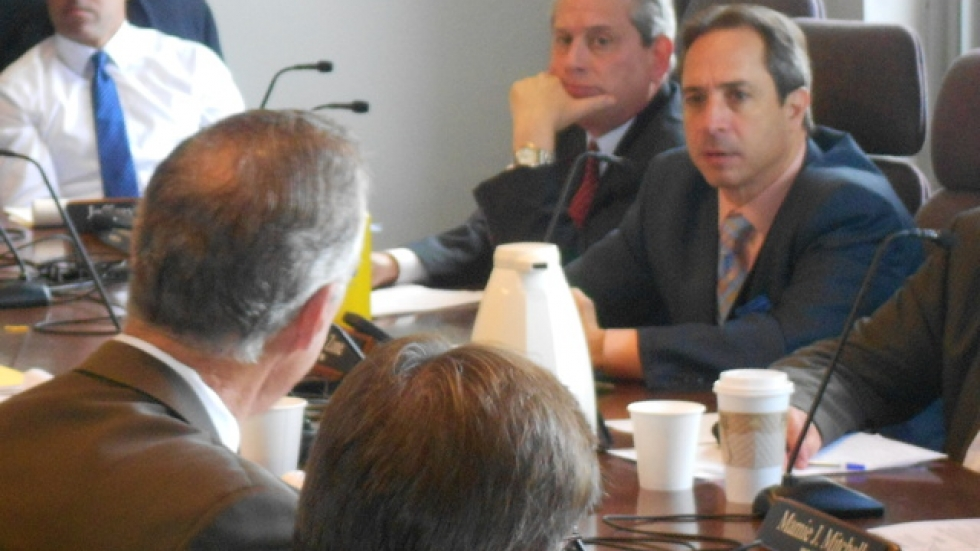 City councilmen Mike Polensek, left, and Matt Zone listen to testimony from health officials and emergency responders.