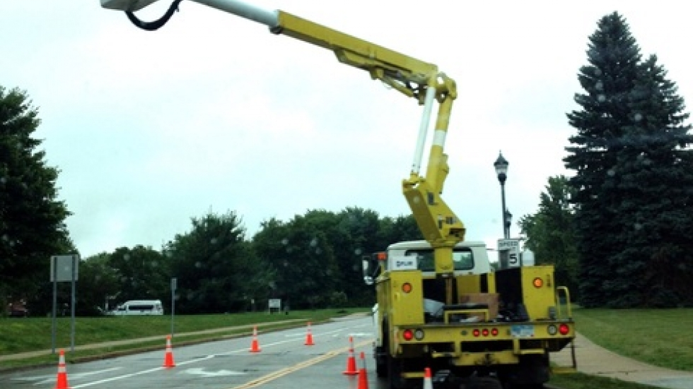 Utility worker checks on stoplight in Solon (pic: Brian Bull)