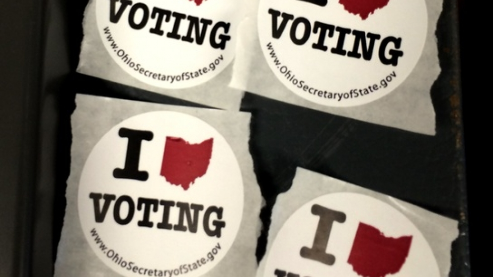 Stickers adorn a ballot scanning machine (WCPN photo)