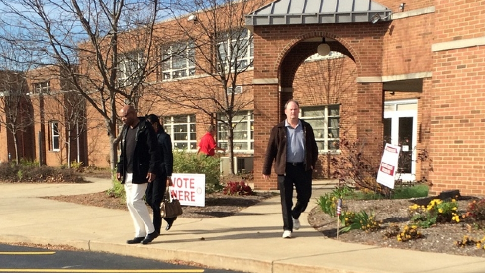 Voters leave a Twinsburg polling station yesterday (pic: Brian Bull)