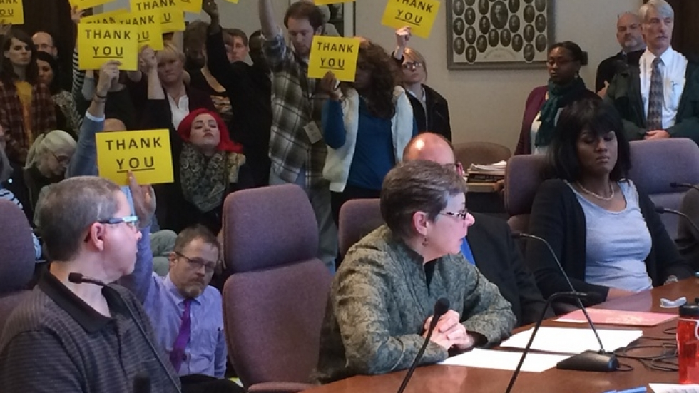 Activists showed support as the ACLU's Susan Becker urged City Council members to strengthen anti-discrimination laws.