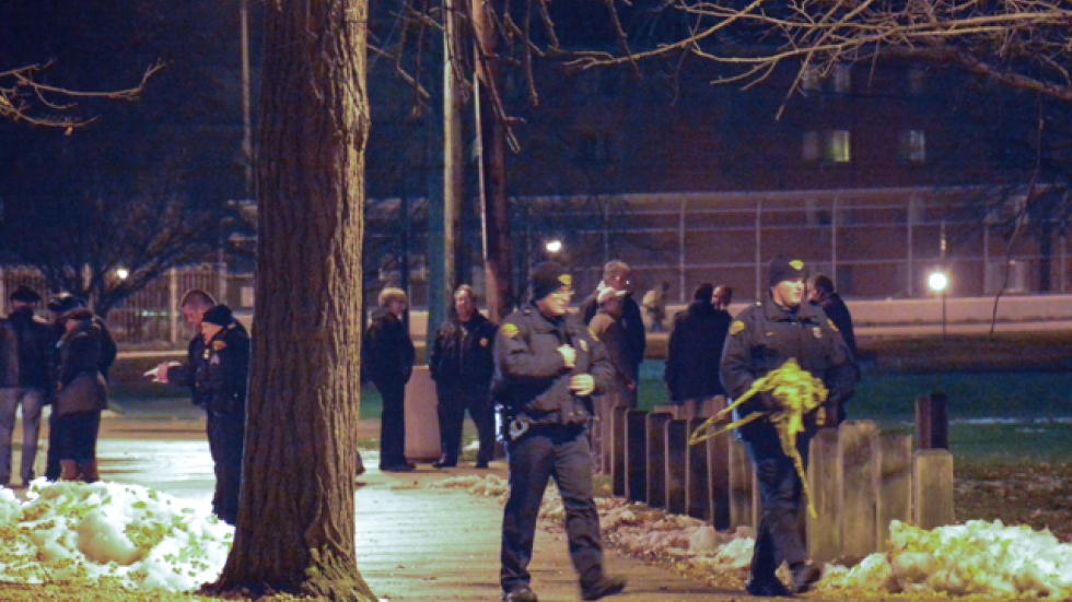 Cleveland police officers clear away yellow tape at Cudell rec center. (Nick Castele / ideastream)