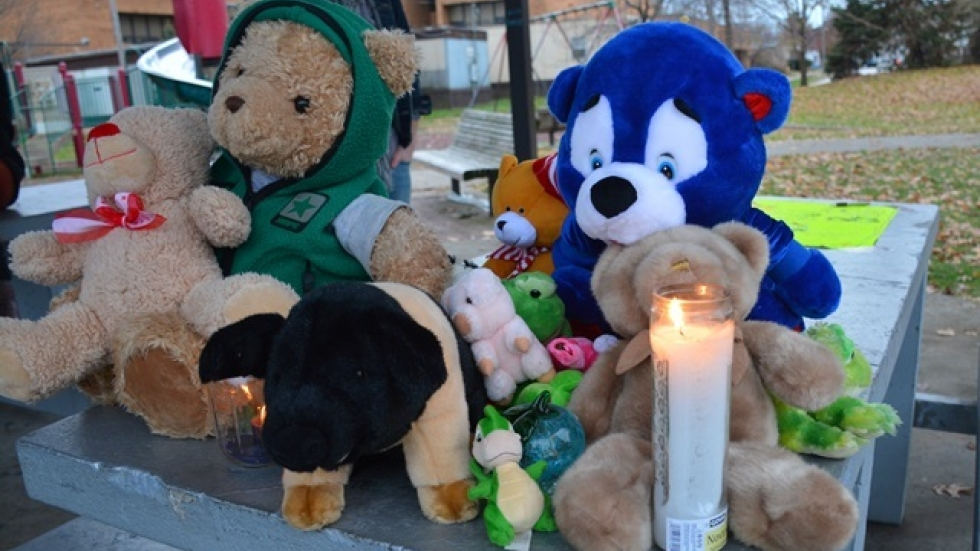 Neighbors and activists set up a memorial to Tamir Rice in the park where an officer shot him. (Nick Castele/ideastream)