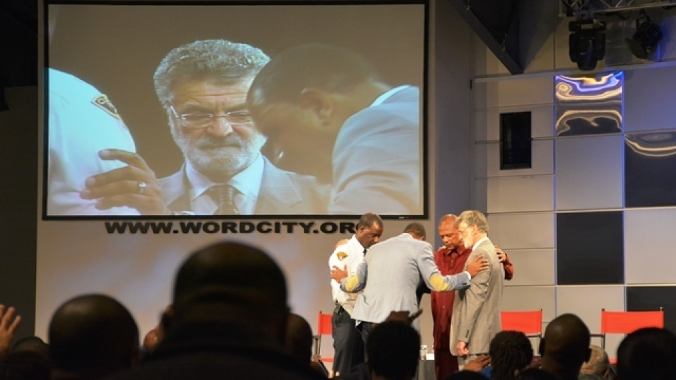 Pastors pray over Mayor Frank Jackson and Police Chief Calvin Williams.