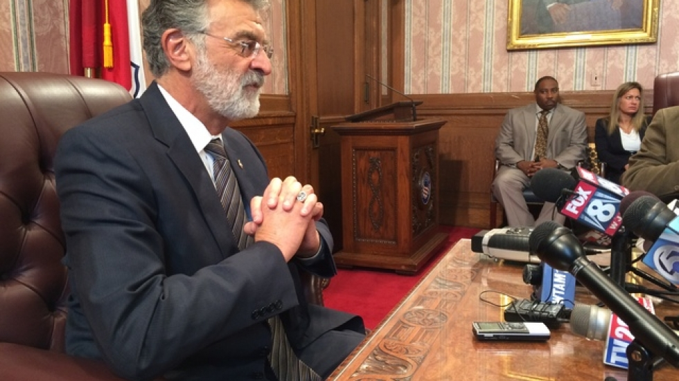 Mayor Frank Jackson talks with reporters about problems with city policing at a news conference Thursday at City Hall.