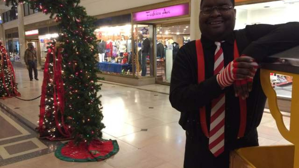 Mike Brown, Kringle's Inventionasium train conductor and candidate for a kidney transplant, at the Tower City Center.