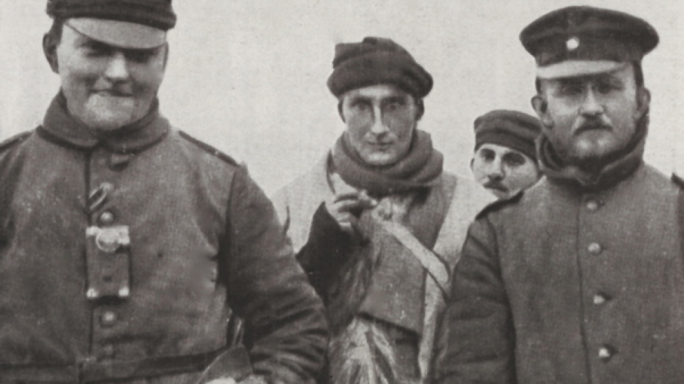 Three Germans and one British soldier sharing holiday cheer during the 1914 Christmas Truce