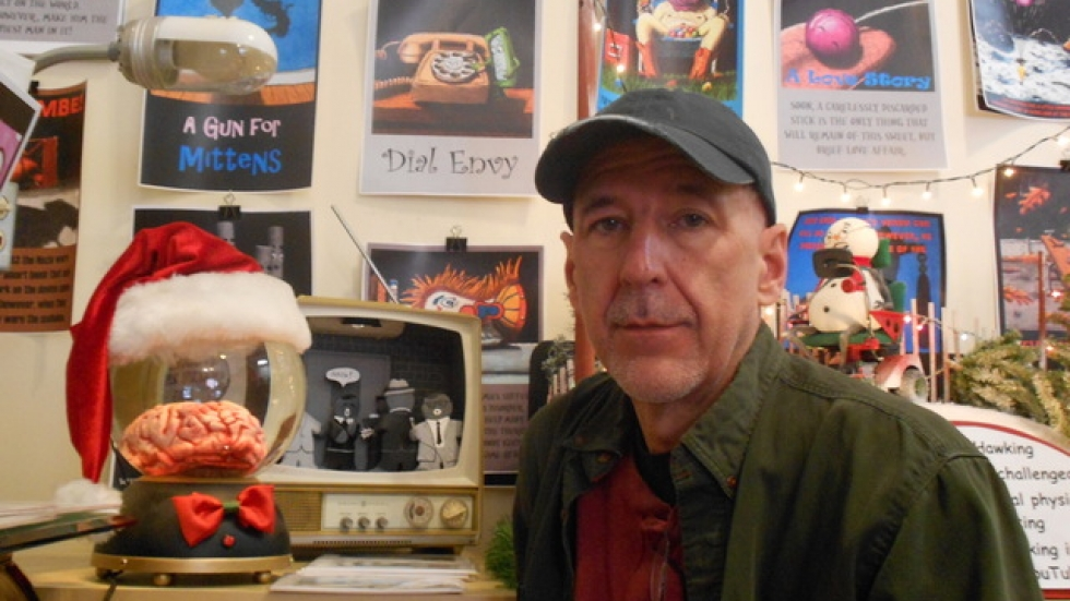 Keith McGuckin, with 'Bing's Brain,' and a recreation of the Lee Harvey Oswald assassination in gingerbread men.