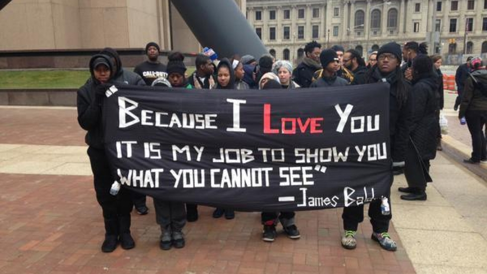 Counter demonstrators displayed a quote from African American writer James Baldwin (TWITTER: New Abolitionist Assn)