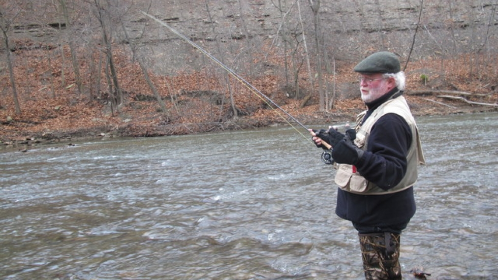 Terry Uhl casts his line into the water where he thinks fish may lurk (pic: Brian Bull)