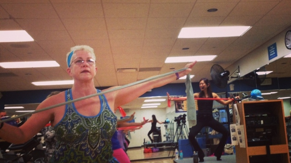 Instructor Mary Beth Horton participates in a Bike & Barre class at the Mandel JCC in Beachwood.  (Photo by Sarah Jane Tribble)