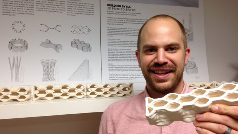 KSU Assistant Professor of Architecture Brian Peters and a ceramic printer produced by a 3D printer.