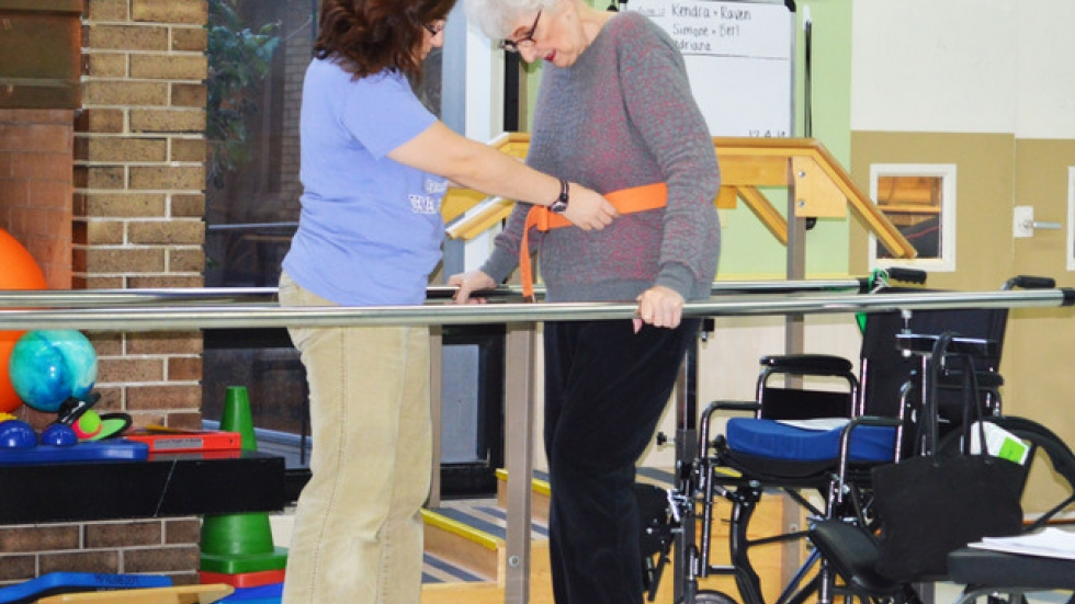 Rhoda Silver working with physical therapist at Menorah Park Center for Senior Living.