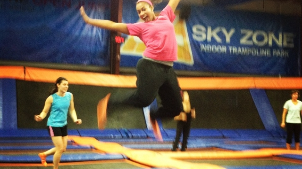 Ideastream's Lauren Wilson jumps during class at Sky Zone Indoor Trampoline Park in Westlake. (Photo by Sarah Jane Tribble)