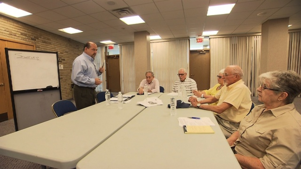 Paul Sobel leads meeting to organize Eastside Connections Village.