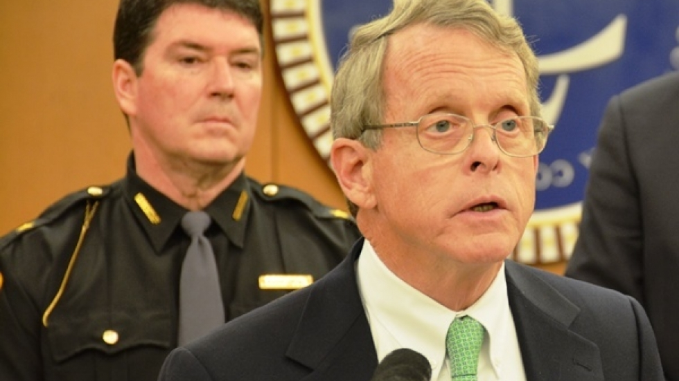 Attorney General Mike DeWine speaks at a Nov. 2014 press conference as Cuyahoga County Sheriff Frank Bova looks on.