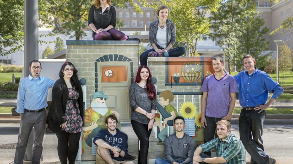 Cleveland Institute of Art students pose by one of their Euclid Avenue creations (PHOTO: Cleveland Institute of Art)