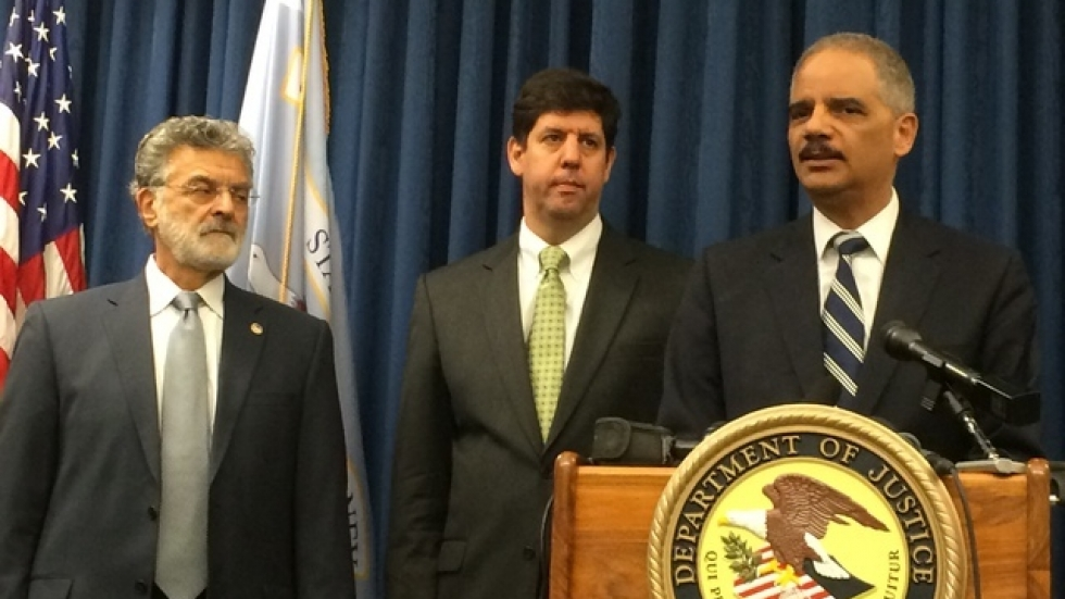 Attorney General Eric Holder speaks, with Mayor Frank Jackson, far left, and U.S. Attorney Steven Dettelbach.