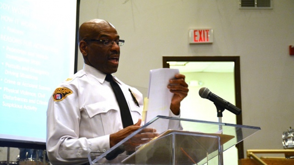 Deputy Chief Leroy Morrow delivers a presentation in Cleveland's Mount Pleasant neighborhood. (Nick Castele/ideastream)
