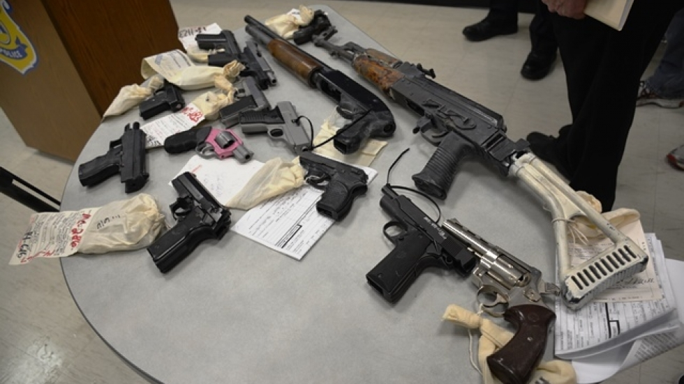 At a new conference, police presented firearms seized during the investigation. (Nick Castele / ideastream)