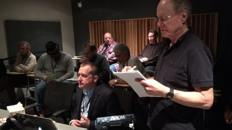 Guitarist Dean Parks takes notes on a track