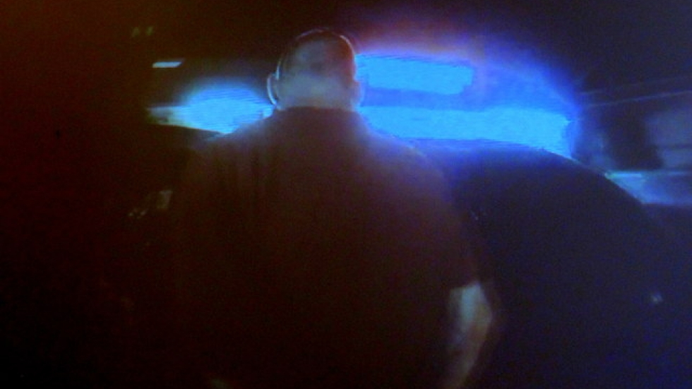 An apprehended suspect is taken to a police car, filmed on a body cam by the CPD (pic: Brian Bull)
