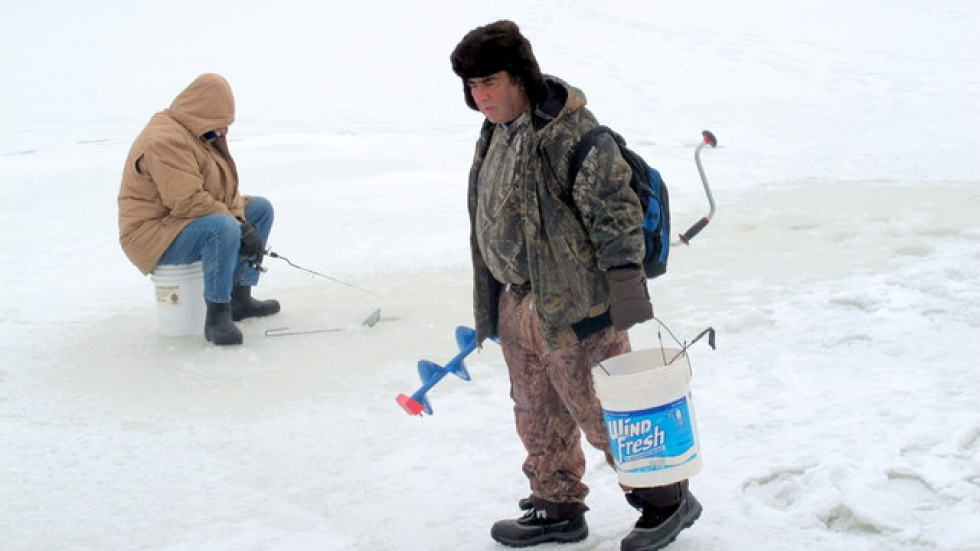 Ice fishermen arrive with their tackleboxes and ice-cutting tools, like this auger (pic: Brian Bull)