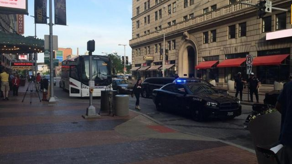 A motorcade drives through Playhouse Square during an RNC visit last year. (ideastream file photo by Tony Ganzer)