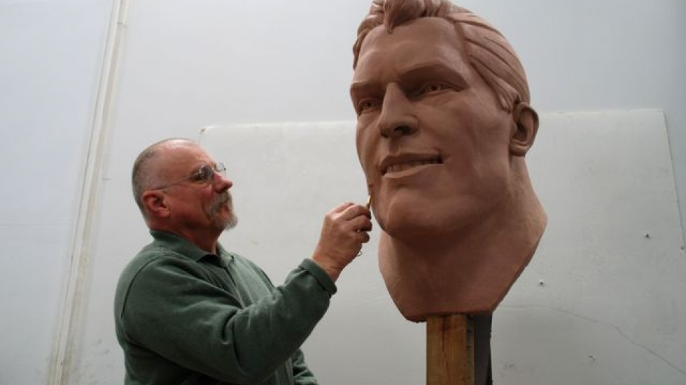 David Deming working on the larger than life head of his 12-foot-long Superman