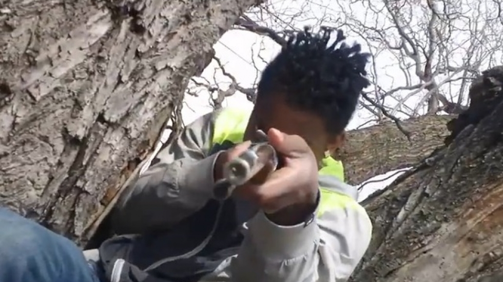 Rasheen Bledsoe Jr aka Marii Jetz points a gun toward the camera. He died in July. (YouTube screenshot)