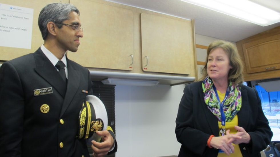 Murthy visits Phyllis Cleary inside a traveling ACA enrolllment bus at MetroHealth (pic: Brian Bull)