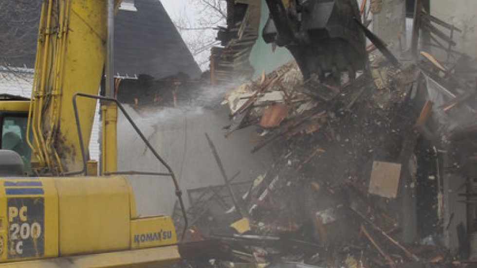 The excavator takes another swipe against the foreclosure (pic: Brian Bull)