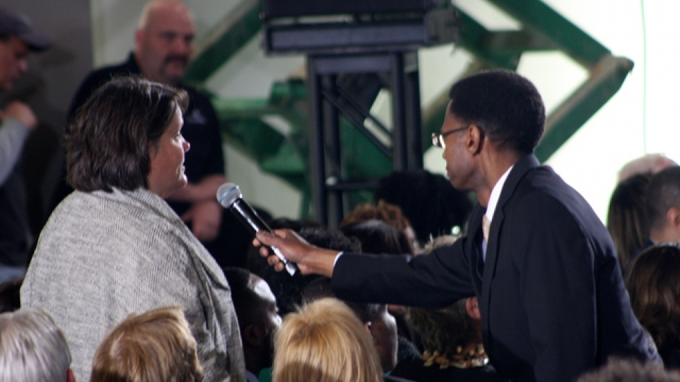 An audience member asks the president a question during the QnA session (photo by ideastream's Brian Bull)