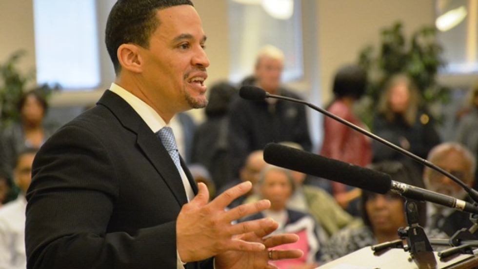 East Cleveland Mayor Gary Norton speaks to residents at a meeting.