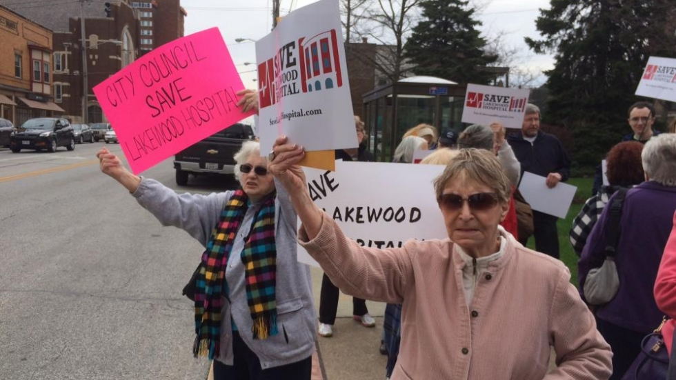 Lakewood residents Anne Allen, right, Marie Birsic, left, protest the hospital's closure.
