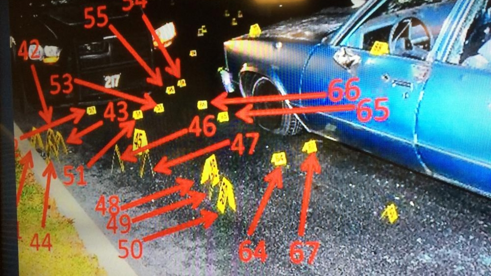 A photo of Russell's car showing where bullets landed, referenced as evidence on the trial's first day