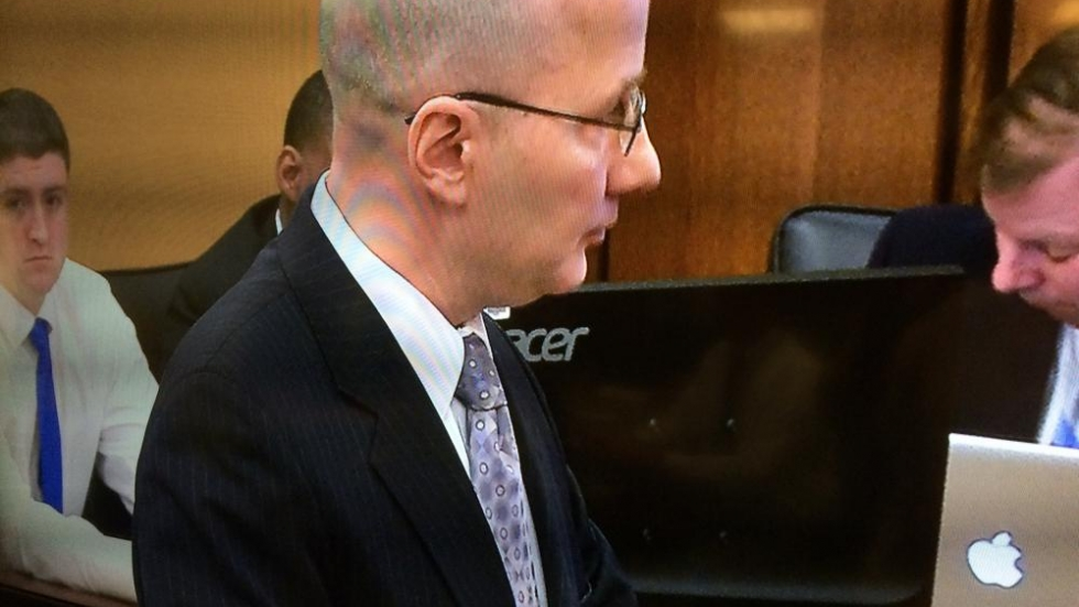 Prosecutor Rick Bell during opening arguments, with Brelo looking on behind him.
