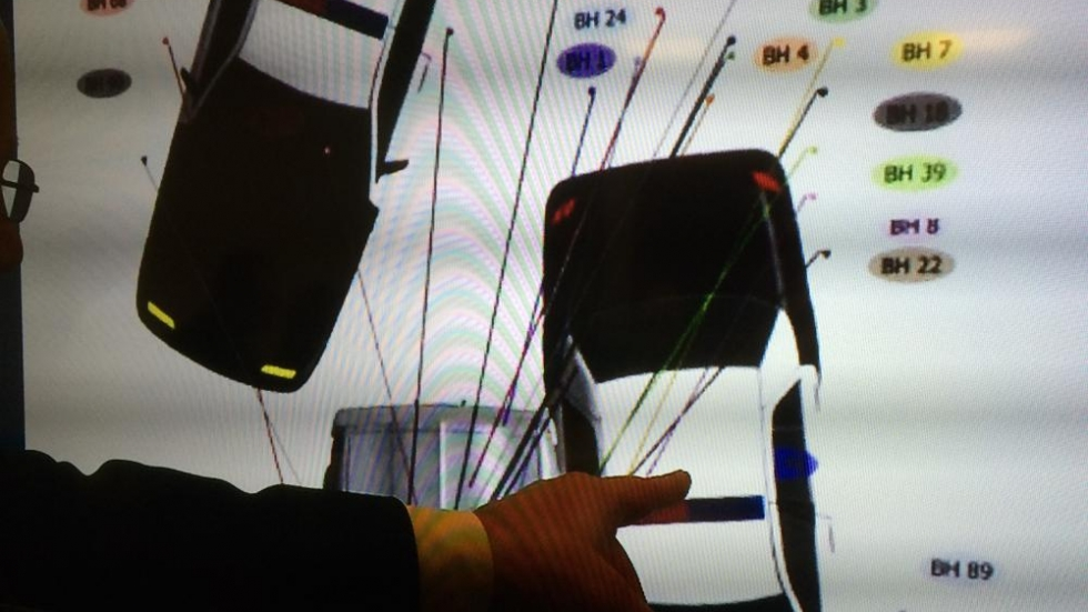 Prosecutor Rick Bell referred to diagrams and photos showing where bullets landed at the shooting scene.