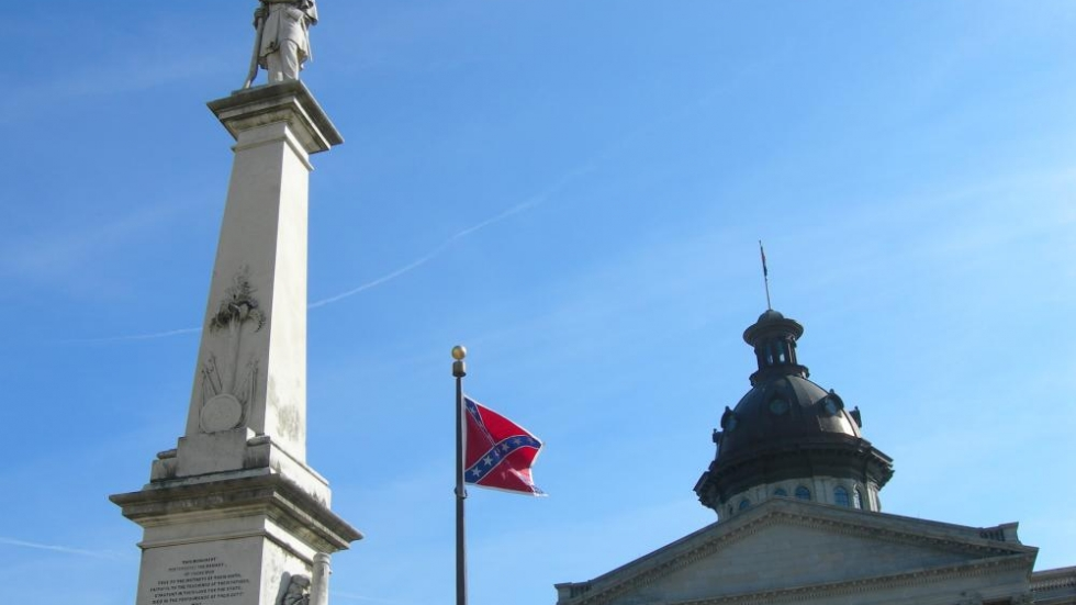 The Confederate flag in front of the South Carolina statehouse. Photo by Jimmy Everson, DVM, via Flickr