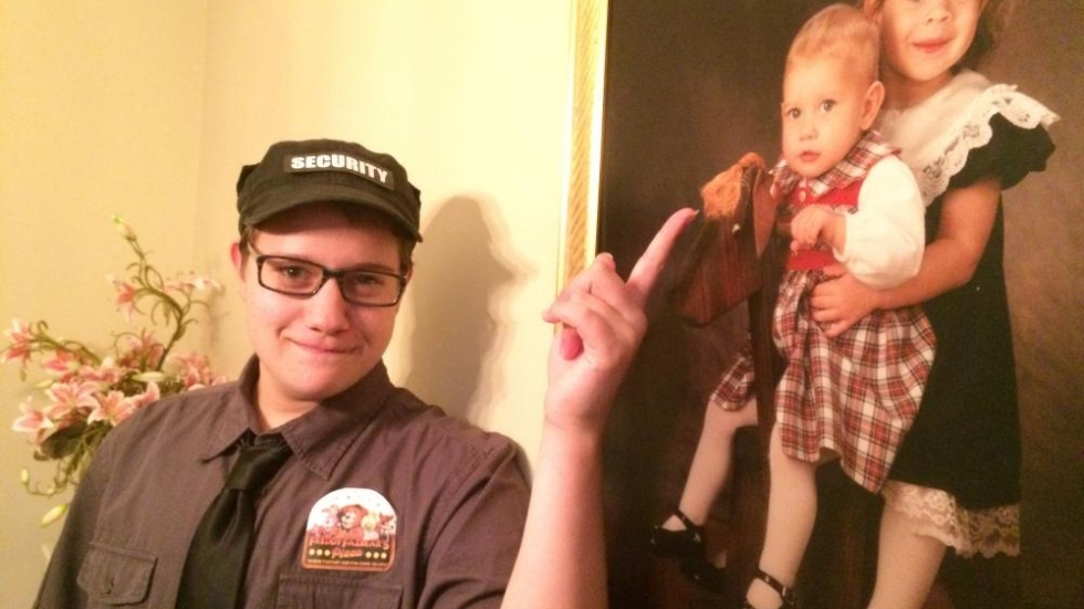 Keith Freund, 17, of Hudson, points to his baby portrait. Back then, he was known as Kathryn. Photo by Joanna Richards