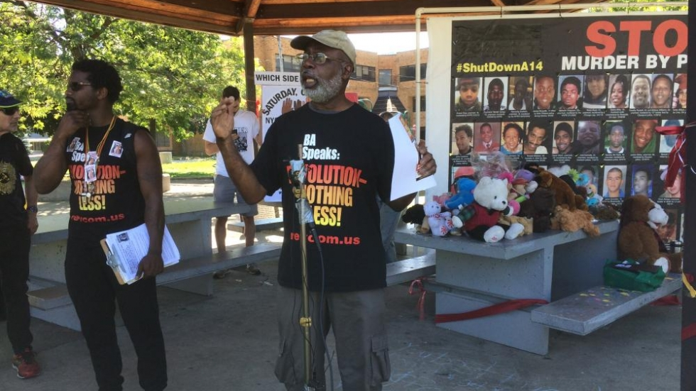 Brooklyn, New York-based activist Carl Dix, an organizer of the national tour, speaks outside Cudell Recreation Center Wednesday. Stuffed animals on a picnic table behind him stand as a memorial to Tamir Rice, who was killed by police in November. Photo by Joanna Richards