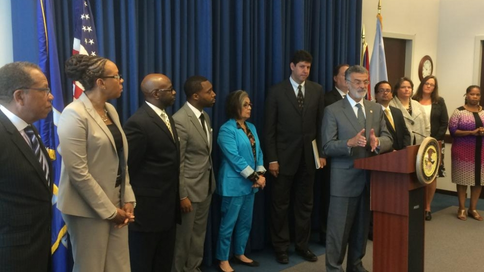 Cleveland Mayor Frank Jackson, flanked by U.S. Attorney Steven Dettelbach and most members of the panel that will choose 10 members of the Community Police Commission. Photo by Joanna Richards