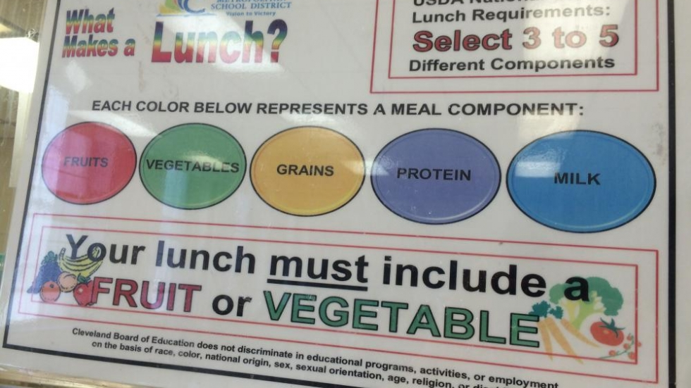 "The federal government says: ""Eat your vegetables, kids!"" in Collinwood High School's cafeteria. Photo by Joanna Richards"