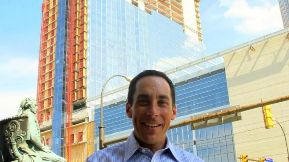 RNC Host Committee CEO David Gilbert, with new Hilton Hotel under construction (pic: Brian Bull)
