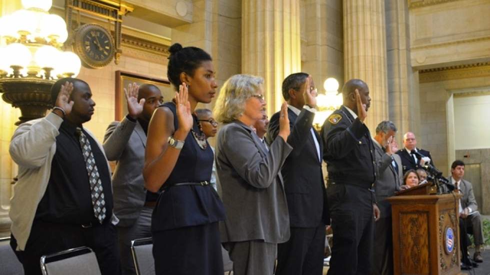 Members of Cleveland's community police commission take the oath of office.