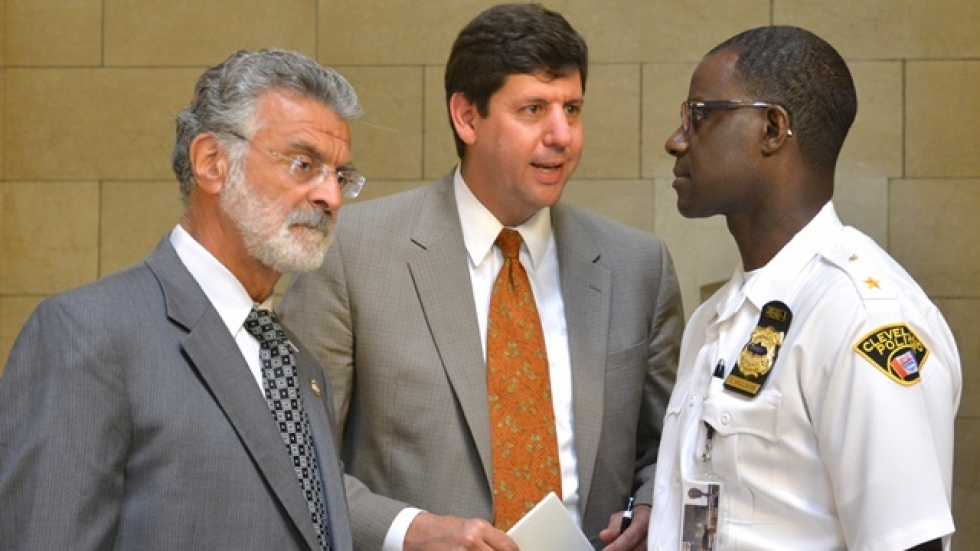U.S. Attorney Steven Dettelbach, center, talks with Mayor Frank Jackson, left, and Police Chief Calvin Williams, right.