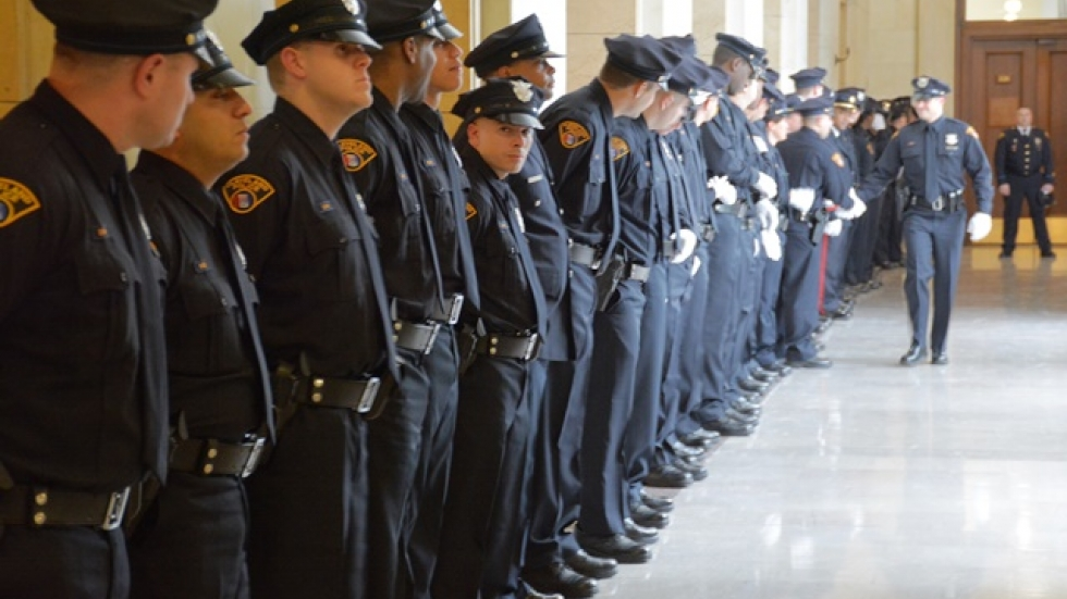 A new class of police officers lines up in Cleveland city hall in 2015.